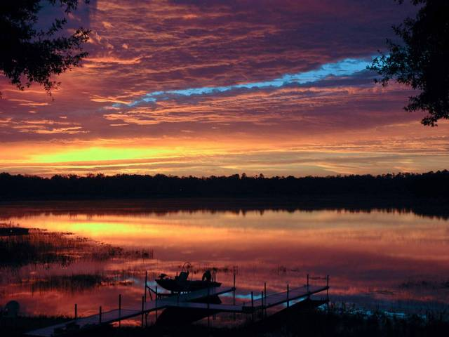Enjoy a beautiful sunset in Clay County set against a backdrop of native wetlands.