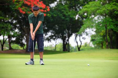Teen playing golf 9-10-14